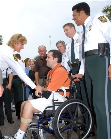 Everyone was all smiles as Maj. Kim Tierney greeted Dep. Maury Hernandez with his parents, Chief Chris McKinstry, Sgt. Rob Furman and Lt. Col. Danny Wright lookingon.