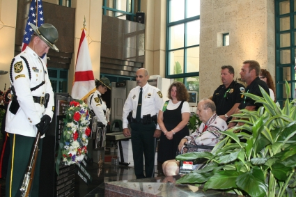 Sheriff Al Lamberti (center) stands with (from  l. to r.): Stefanie Tephford, Tony Yanniello (seated), Coral Springs Police Sgt. Bob Behan, Megan Behan (not seen), and Yanniello family friend Sam Rumble Thursday morning at a memorial service for five public servants who died in the line of duty.