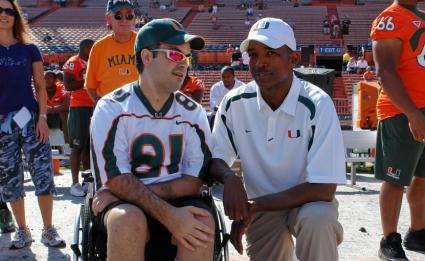 Deputy Maury Hernandez and Miami Hurricanes head coach Randy Shannon