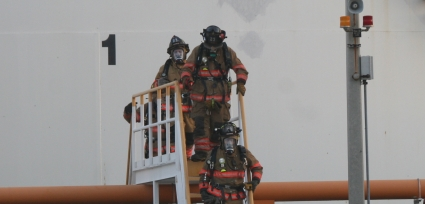 Hazardous Materials Technicians from Broward Sheriff Fire Rescue mitigate a gasoline leak at the BP Products fuel depot at Port Everglades in the evening of Friday, March7th