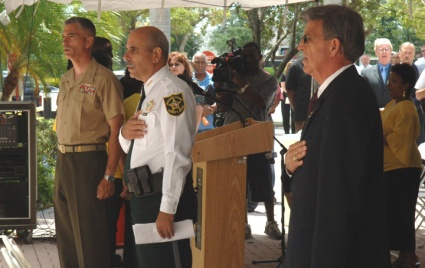 Sheriff Al Lamberti and BSO Chaplain Rick Braswell say the Pledge of Allegiance at start of a National Day of Prayer event.