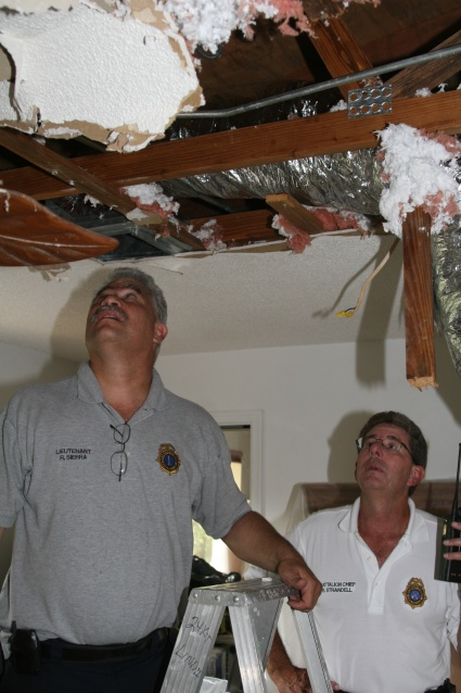 FIREFIGHTERS RESCUE SHOCKED MAN TRAPPED IN ATTIC